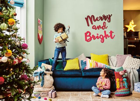 Children opening christmas presents photo