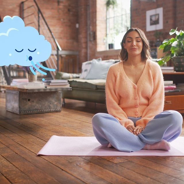 frankie bridge looking zen, sitting crosslegged on a yoga mat with a cloud cartoon breathing gently next to her