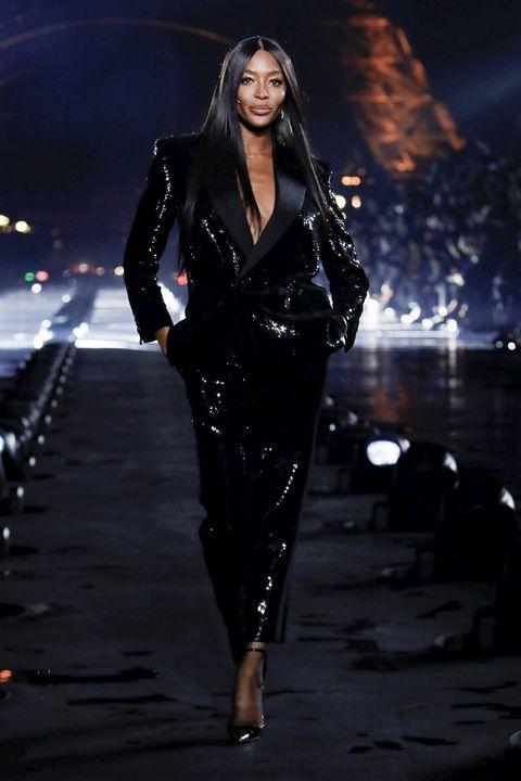 Fashion model, Fashion, Runway, Fashion show, Haute couture, Latex clothing, Event, Photography, Fashion design, Model,