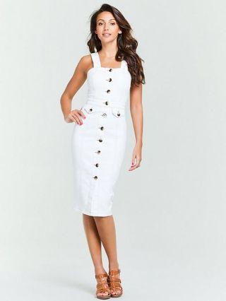 Very white pinafore dress