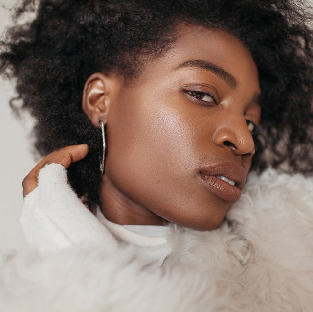 woman in furry jacket with nude lipstick