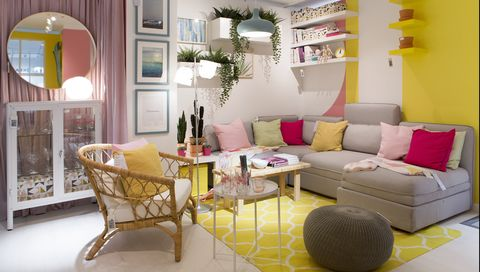 Living room, Room, Interior design, Furniture, Property, Yellow, Coffee table, Building, Pink, Home,