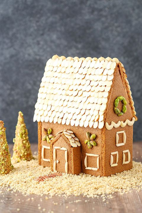 Gingerbread house, Gingerbread, Icing, Dessert, House, Food, Buttercream, Sugar paste, Interior design, Baked goods,