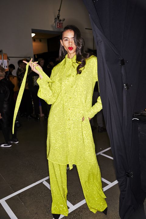 Clothing, Yellow, Fashion, Outerwear, Fashion design, Pantsuit, Costume, Costume design, Suit,