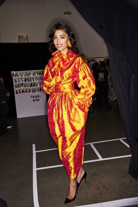 Clothing, Fashion, Fashion design, Orange, Costume, Dress, Fun, Performance, Textile, Event,
