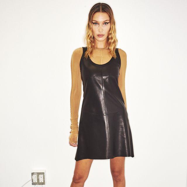 Clothing, Fashion model, Dress, Fashion, Little black dress, Cocktail dress, Footwear, Shoulder, Fashion design, Leg,