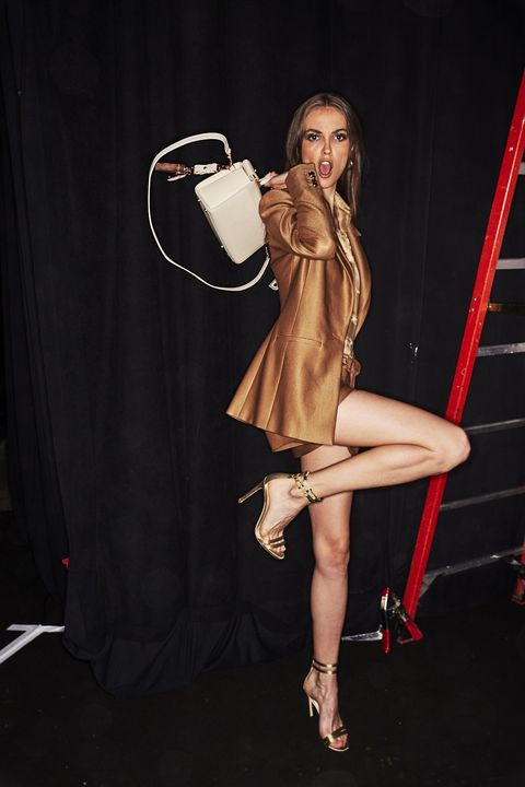 Leg, Performance, Fashion, Thigh, Fashion model, Blond, Human body, Human leg, Dress, Photo shoot,