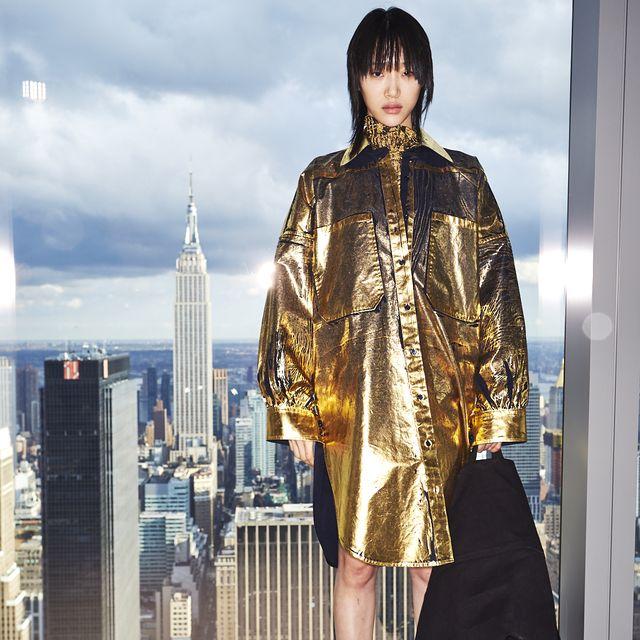 Clothing, Fashion, Beauty, Yellow, Street fashion, Outerwear, Fashion design, Fashion model, Architecture, Costume,