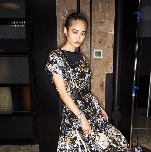 Fashion model, Clothing, Dress, Fashion, Street fashion, Fashion design, Shoulder, Footwear, Leg, Design,