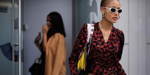 Eyewear, Clothing, Fashion, Street fashion, Sunglasses, Jeans, Yellow, Shoulder, Outerwear, Fashion design,