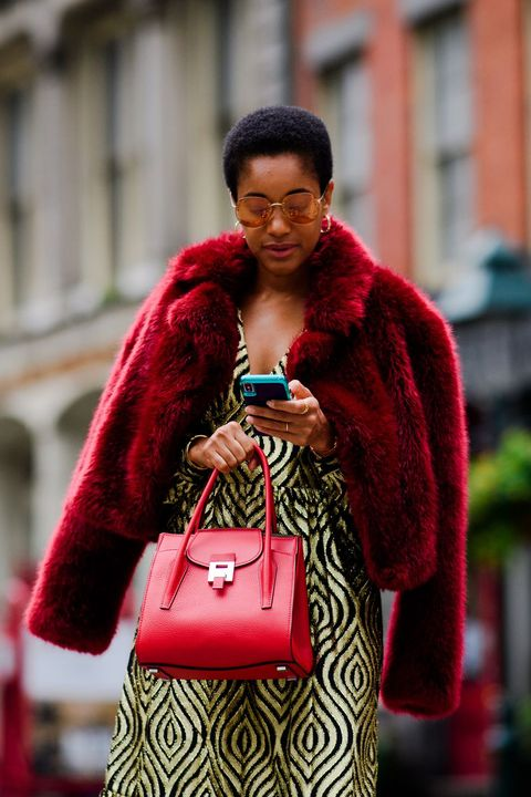 Street fashion, Red, Fur, Fashion, Fur clothing, Outerwear, Human, Textile, Fashion accessory, Photography,