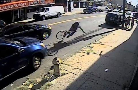 NYPD Runs Cyclist Off Bike
