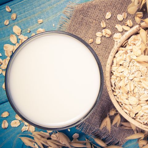 Oat and oat milk. Healthy breakfast, healthy eating concept.