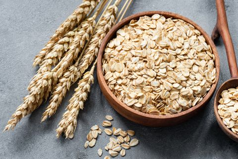 oat flakes or rolled oats in wooden bowl