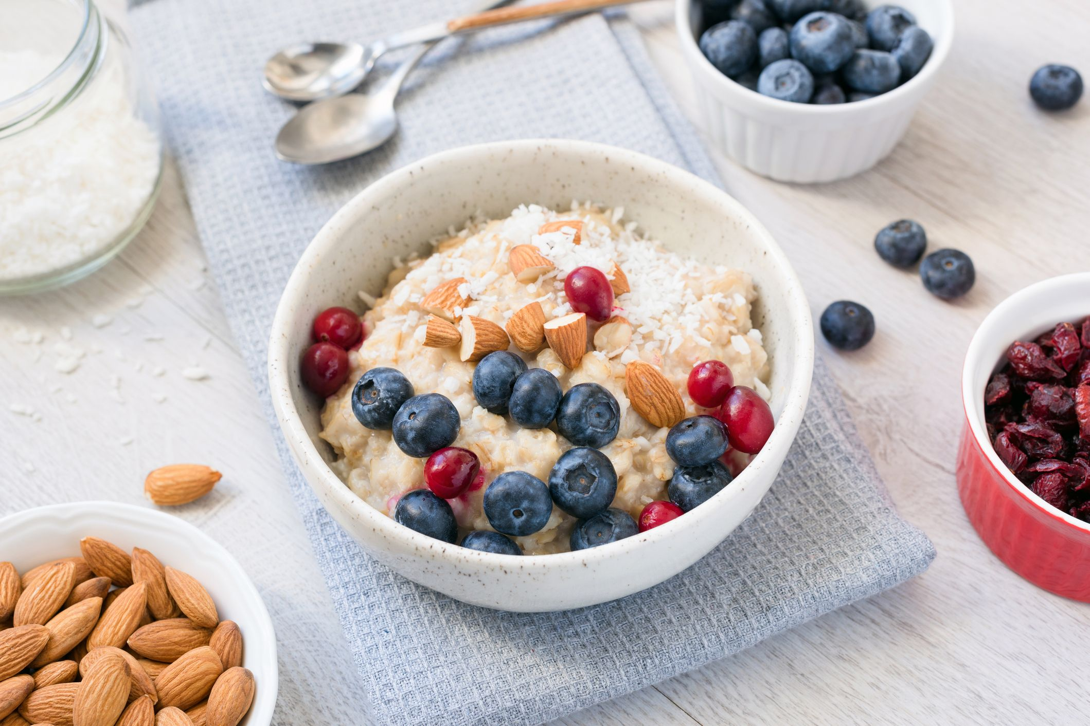Oatmeal porridge bowl wtih blueberries, cranberries, almonds and coconut