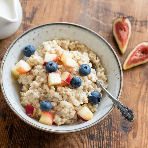oatmeal porridge in a bowl with fruits and berries