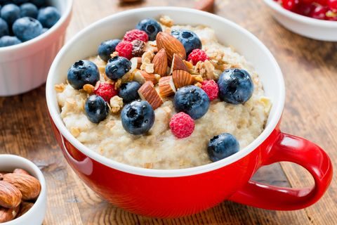 Oatmeal porridge with blueberries, raspberries and almonds