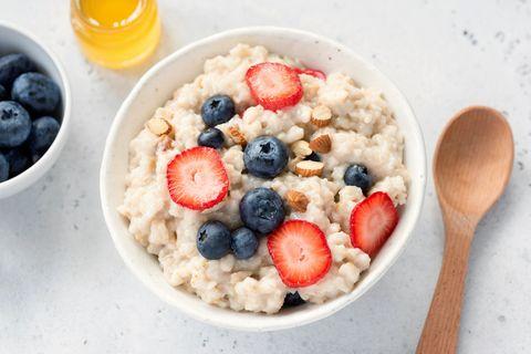 Oatmeal porridge with fresh berries in a bowl