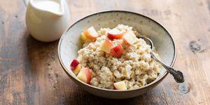 Oatmeal porridge with peach in bowl