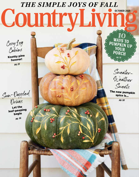 country living october cover featuring a stack of three pumpkins with a winding vine motif carved up the stack
