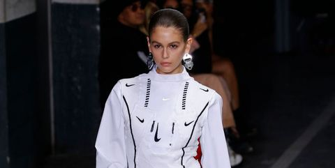 Fashion model, White, Fashion, Clothing, Fashion show, Runway, Street fashion, Public event, Fashion design, Outerwear,