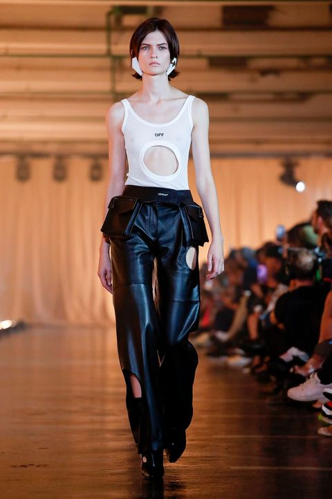 off white springsummer 2020 , cut out tank top with cut out black pants with bag pockets