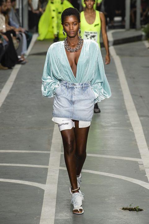 Fashion model, Fashion, White, Fashion show, Clothing, Street fashion, Runway, Beauty, Fashion design, Leg,