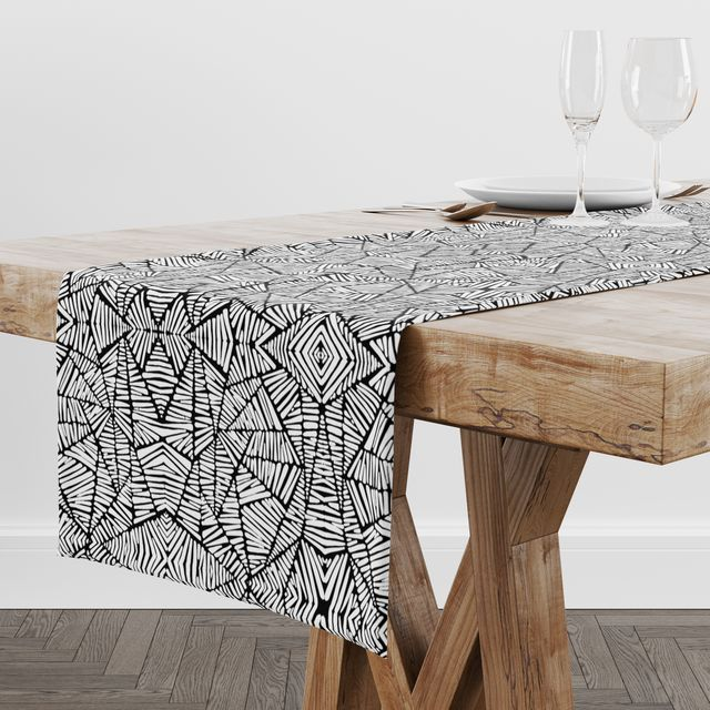 rochelle porter design black and white table runner on top of table