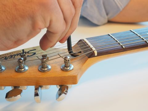 Guitar, Musical instrument, String instrument, String instrument, Plucked string instruments, String instrument accessory, Electric guitar, Guitar accessory, Finger, Acoustic guitar,
