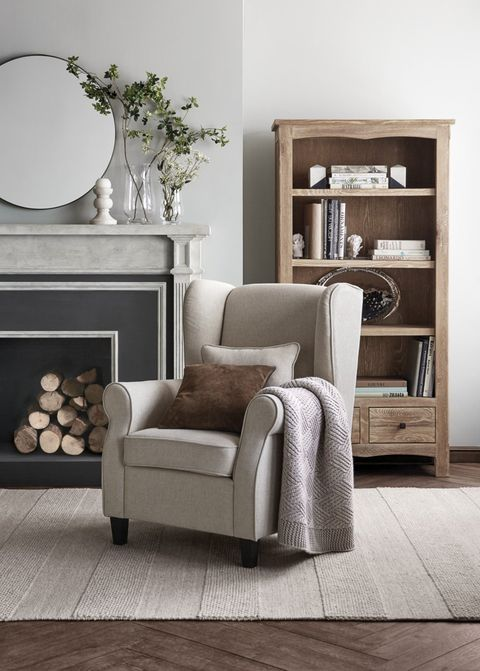 Furniture, Room, Living room, Interior design, Floor, Wall, Wood flooring, Chair, Couch, Table,