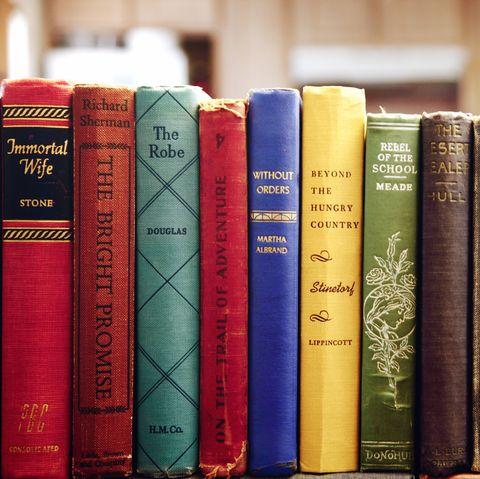 Old Books Arranged On Shelf