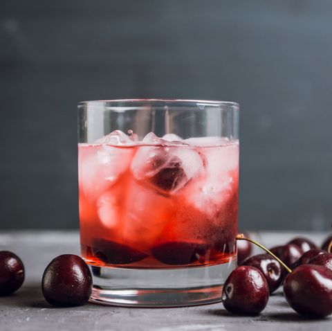 Old fashioned cocktail with cherry