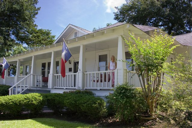 old historical home in southern usa front porch woman texas