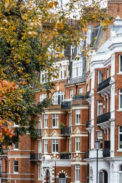 old red brick houses facades in kensington, chelsea, london