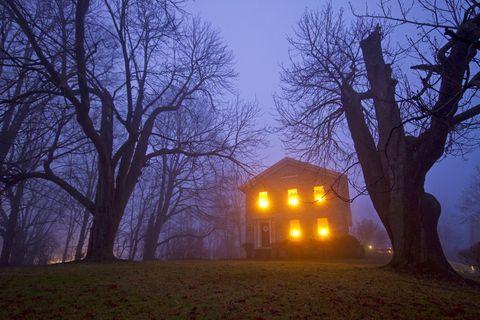 Old stone house on foggy night