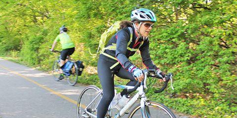 older cyclist riding bike on bike path