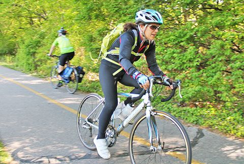 older cyclist riding bike on bike path