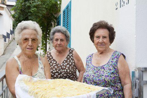 Older women with basket of pasta