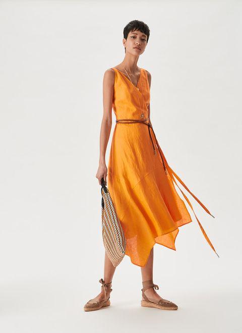 Fashion model, Clothing, Dress, Shoulder, Yellow, Orange, Fashion, Day dress, Standing, Fashion design,