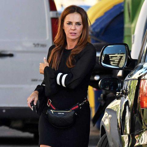 Olga Moreno sale de su coche enMálaga el día de su 43 cumpleaños