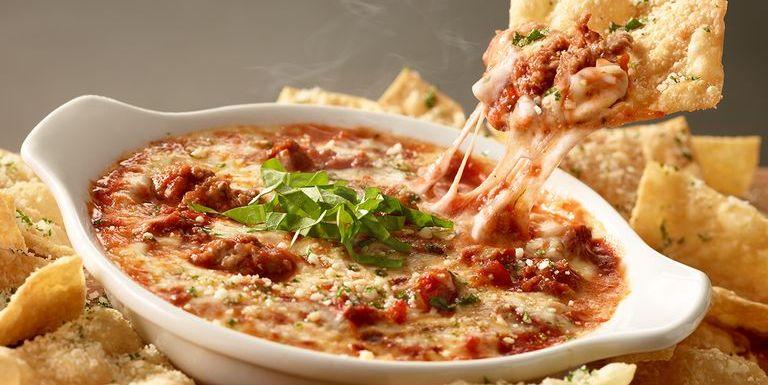 olive garden made a lasagna dip served with pasta chips - Olive Garden Lasagna Recipe