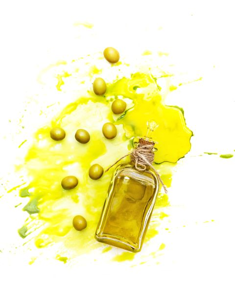 Olive oil and green olives shot from above. Creative food shot with watercolor.