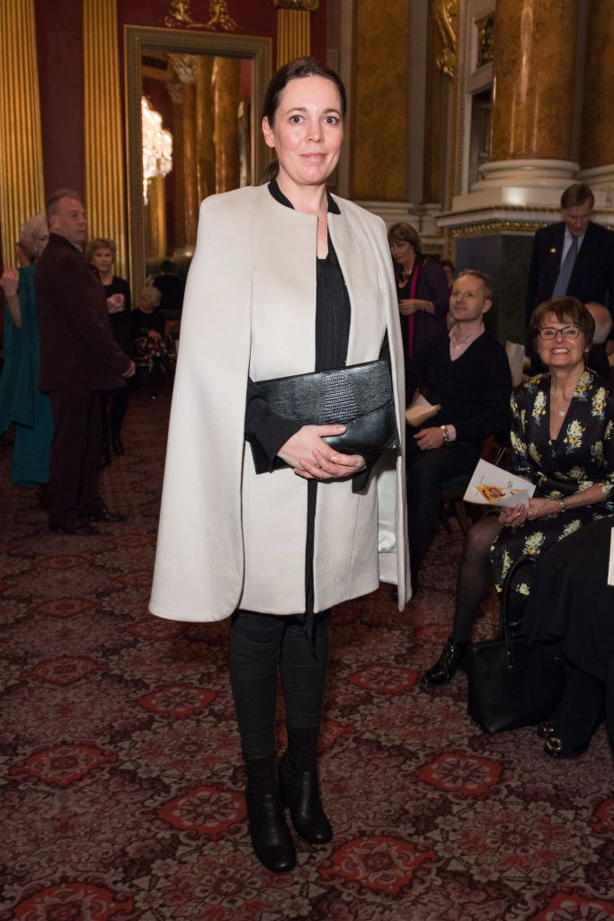 Olivia kept her outfit simple under her cream Suzannah cape as she attended the Suzannah Fashion Show in aid of Mencap in London. SHOP NOW Cashmere Longline Cape, Suzannah, $2,457
