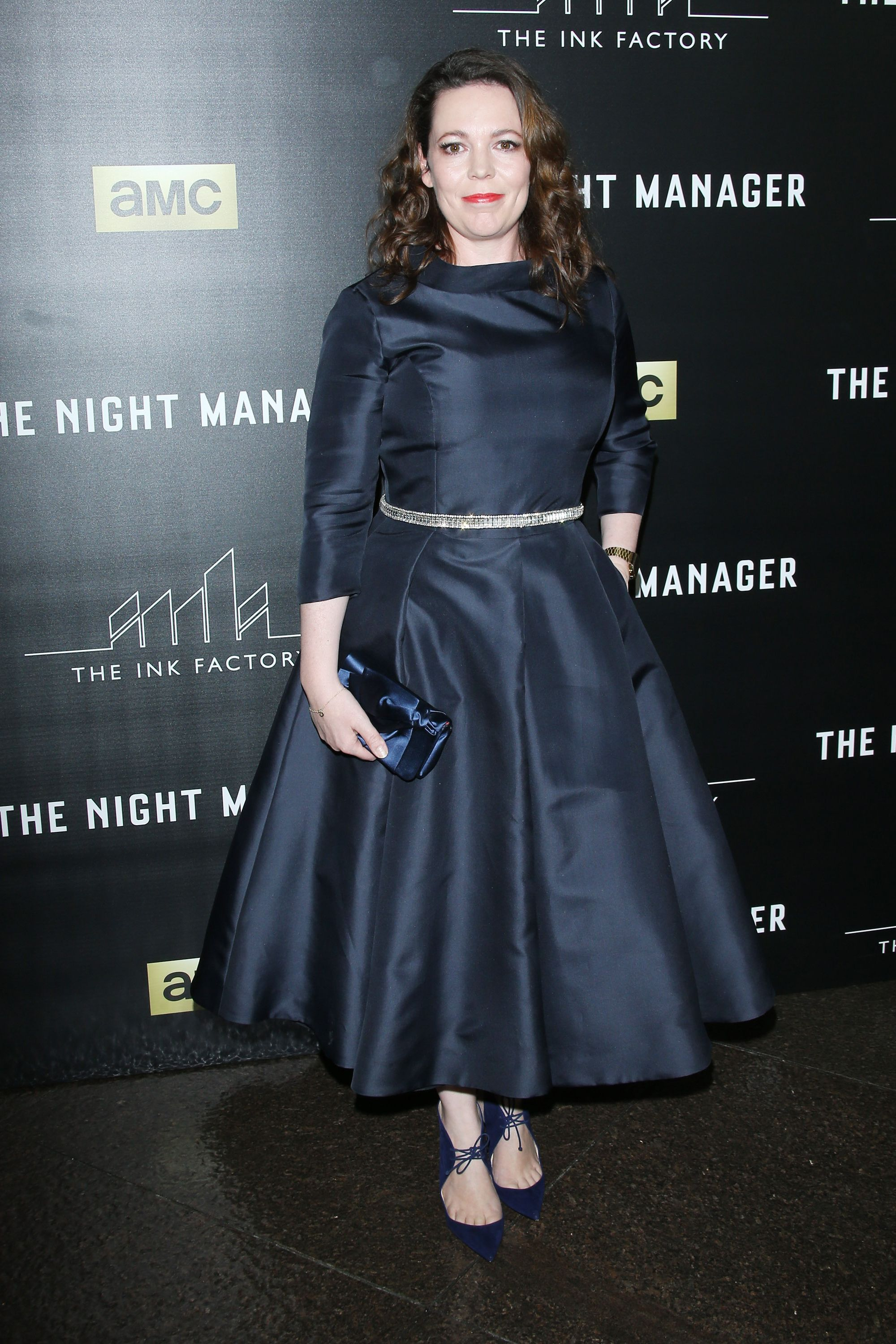 At the premiere of The Night Manager , Colman opted for a navy tea-length dress with a silver belt and dark blue accessories.