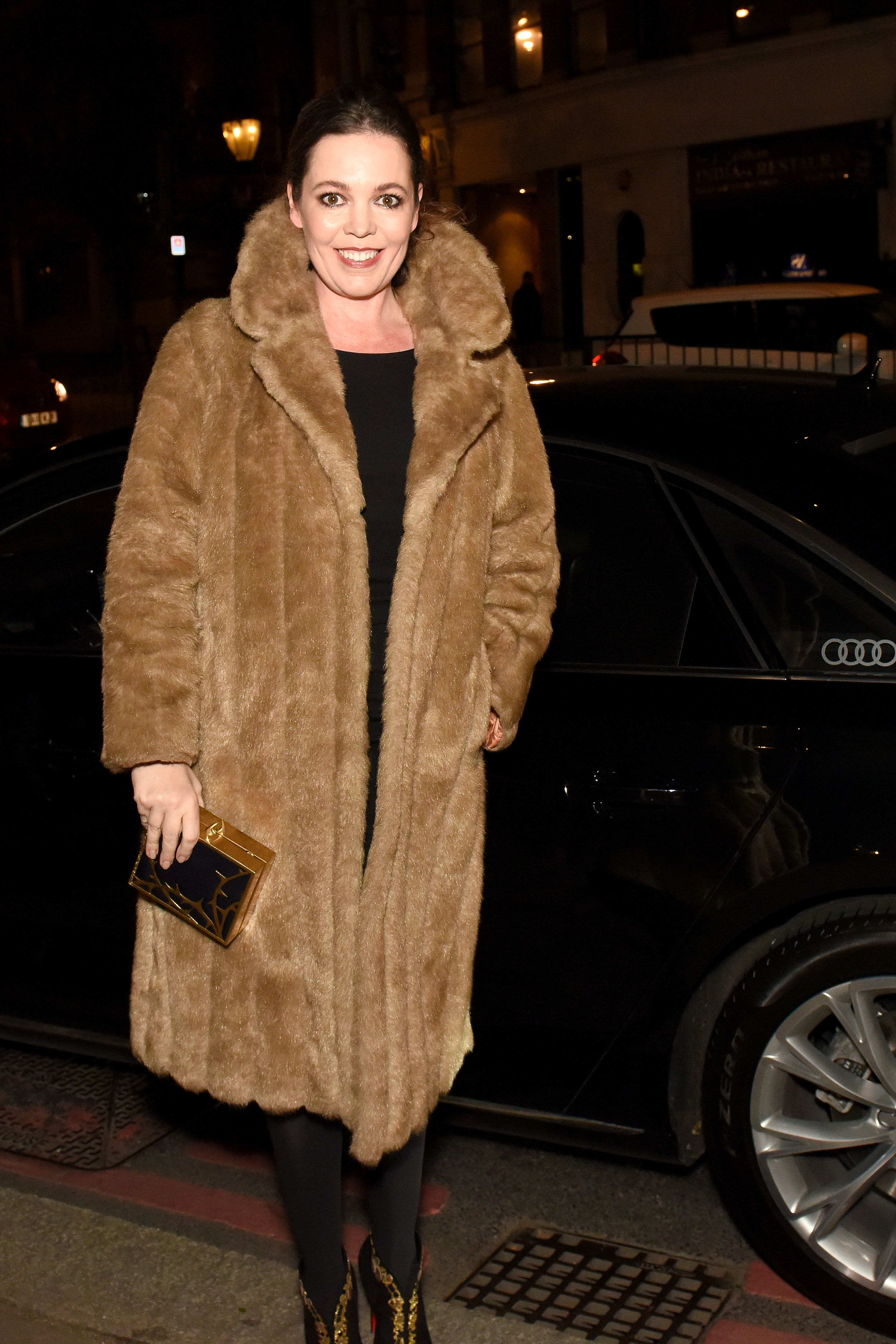 Colman arrived to the British Independent Film Awards wearing a full-length fur coat over her black ensemble.