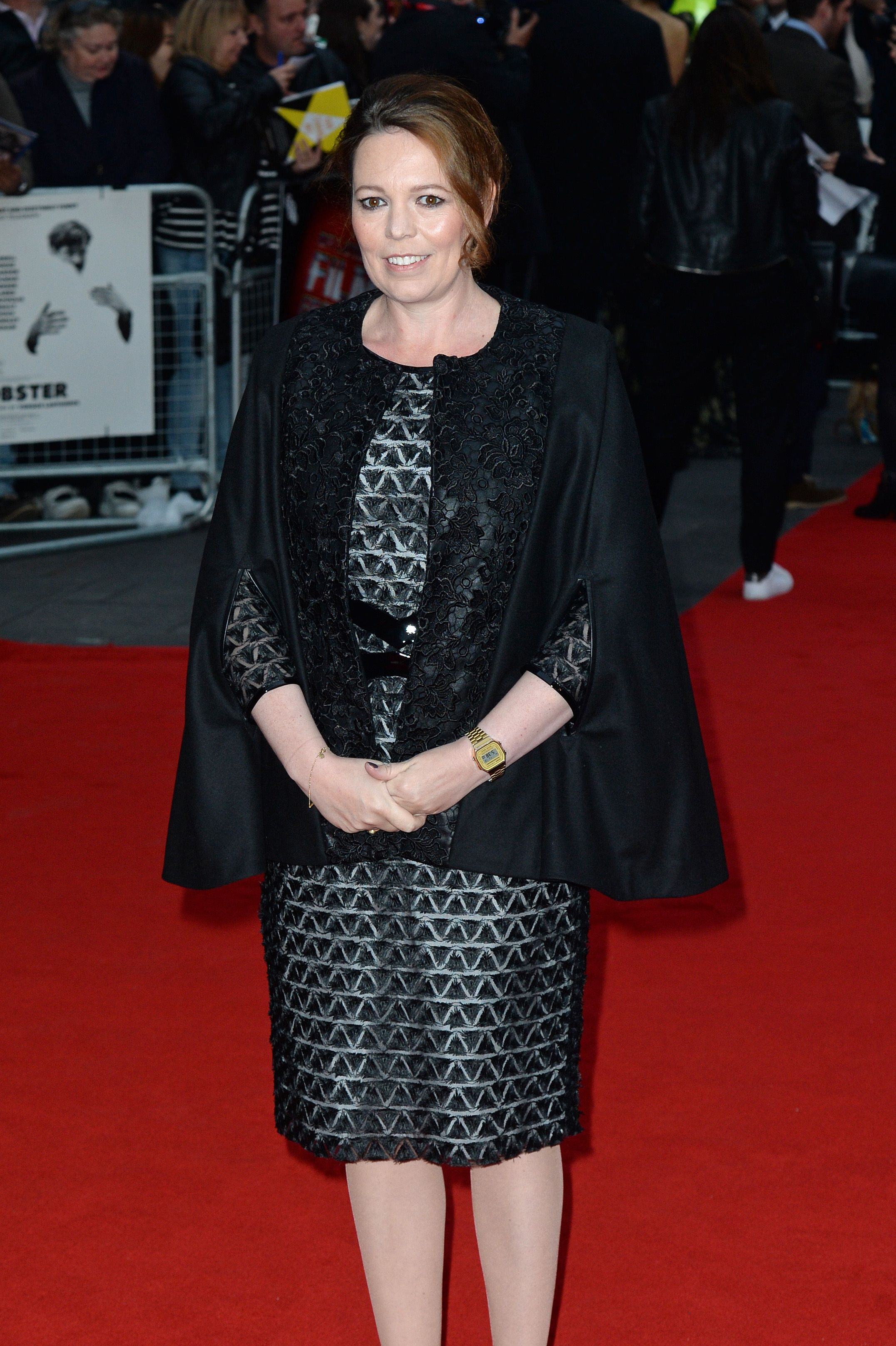 For a screening of The Lobster at the BFI Film Festival in London, Olivia wore a geometric-patterned dress with a chunky belt and black cape.