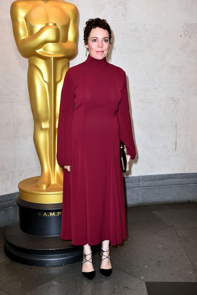 Olivia Colman arrived at the Academy of Motion Picture Arts and Sciences wearing a long-sleeved burgundy gown with drop earrings and black lace-up heels. SHOP SIMILAR Very Matilde 85 Pumps, Aquazzura, $523