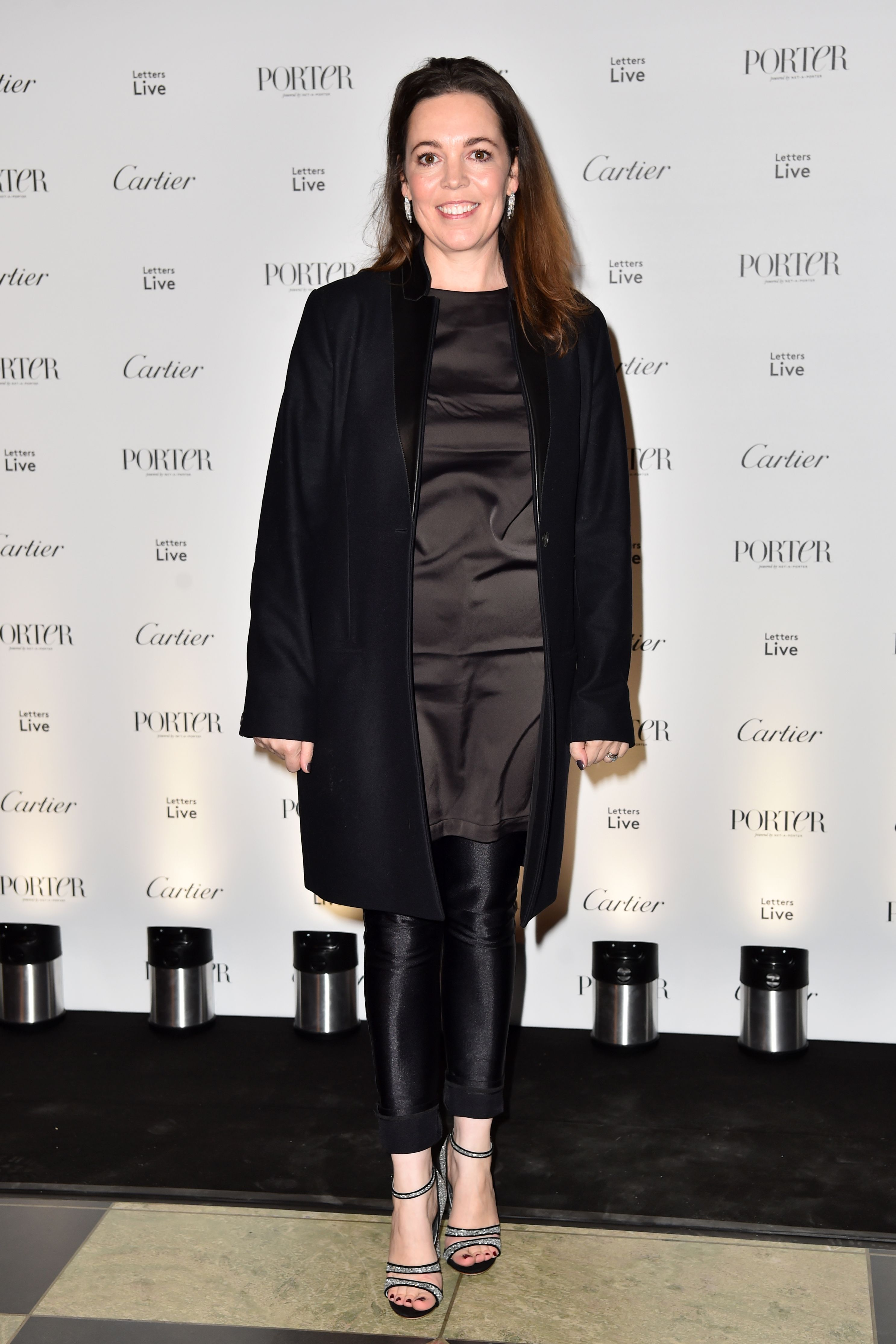 The actress looked chic in an all-black look pairing an oversized coat with a silk dress and leggings for the Letters Live Black Tie Gala Dinner in London