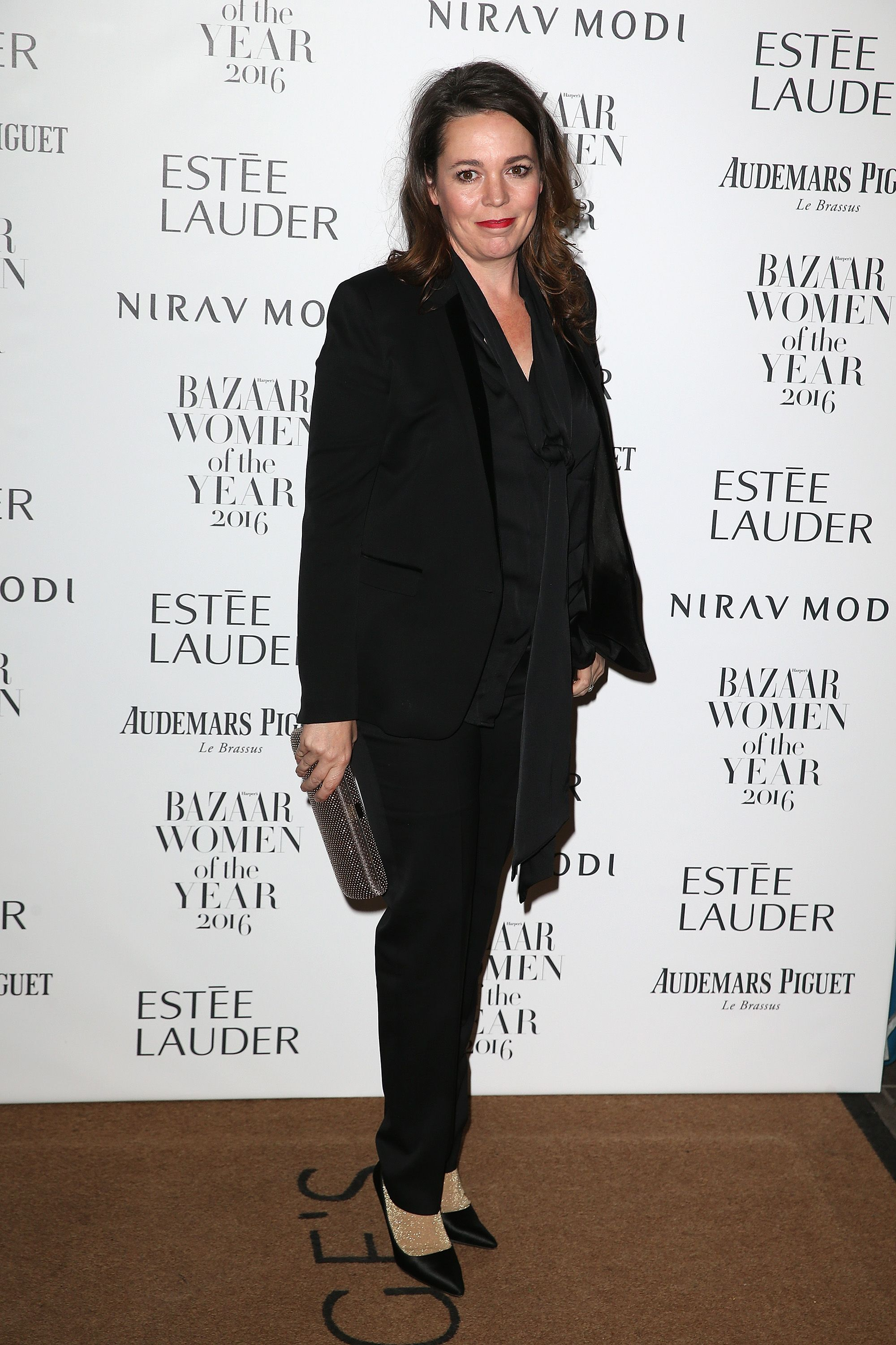Colman is the queen of adding playful touches to sophisticated suits. At the Harper's Bazaar Women of the Year Awards in 2016, the actress paired gold socks with her black tuxedo suit to give the look a bit of whimsy.
