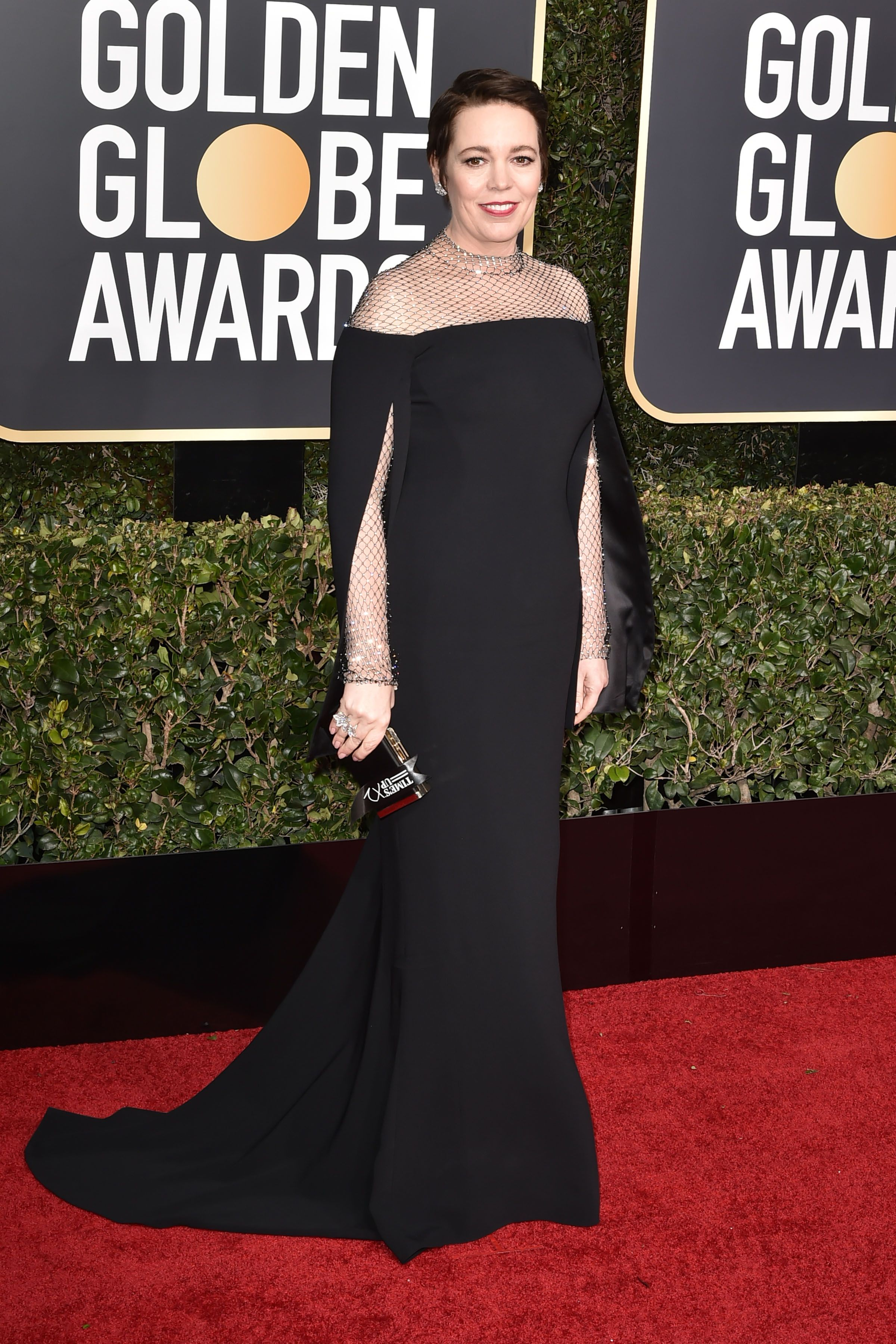 Olivia Colman arrived at the 76th Annual Golden Globe Awards wearing a stunning black gown by Stella McCartney.
